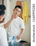 back view of young asian man... | Shutterstock . vector #1160995282