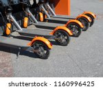electric scooters in row on the ... | Shutterstock . vector #1160996425