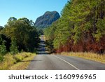the glass house mountains of... | Shutterstock . vector #1160996965