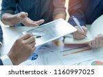 businessteam use a tablet... | Shutterstock . vector #1160997025