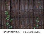 old rusty metal gates | Shutterstock . vector #1161012688