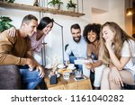 group of cheerful young friends ... | Shutterstock . vector #1161040282