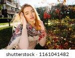 beautiful blue eyed blonde girl ... | Shutterstock . vector #1161041482