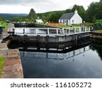 Cullochy Lock on the Caledonian Canal in Scotland - stock photo
