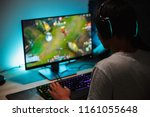 image of immersed teenage gamer ... | Shutterstock . vector #1161055648