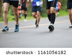 group of people running race... | Shutterstock . vector #1161056182