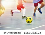 children playing soccer with... | Shutterstock . vector #1161083125