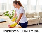 woman in white shirt and yellow ... | Shutterstock . vector #1161125308