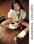 Young slim japanese woman sitting. - stock photo