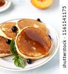 homemade morning pancakes peach ... | Shutterstock . vector #1161141175