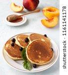homemade morning pancakes peach ... | Shutterstock . vector #1161141178