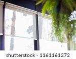 curtain or blinds roller sun... | Shutterstock . vector #1161161272