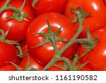 close up of red tomatoes on... | Shutterstock . vector #1161190582