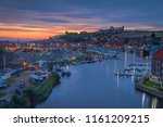 whitby harbour just before... | Shutterstock . vector #1161209215