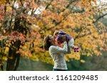 Autumn Scene Of Mother Kissing...