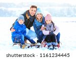 happy family with sledges... | Shutterstock . vector #1161234445