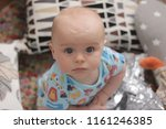 close up of cute baby boy's face | Shutterstock . vector #1161246385