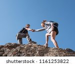 helping hand couple hikers in... | Shutterstock . vector #1161253822