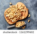 roasted cashew nuts and scoop... | Shutterstock . vector #1161299602