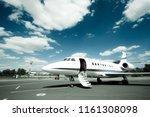business jet with open door... | Shutterstock . vector #1161308098