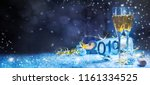 Small photo of Sparkling New Year background. Champagne Explosion With Toast Of Flutes