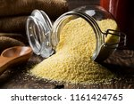 heap of raw  uncooked couscous... | Shutterstock . vector #1161424765