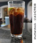rum and cola with lime and ice | Shutterstock . vector #1161429838