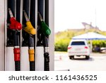 gas station three colorful fuel ... | Shutterstock . vector #1161436525