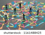 Small photo of Diversify people or social network concept, miniature people businessmen standing on colorful pastel chalk line link and connect between multiple dot or peer on blackboard.
