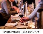 caucasian male hand grabbing a... | Shutterstock . vector #1161540775