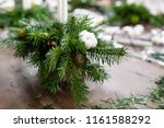 a woman decorates a christmas... | Shutterstock . vector #1161588292