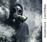 A Man In A Gas Mask In The...