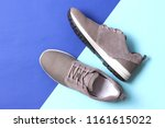 men's sneakers on a colored... | Shutterstock . vector #1161615022