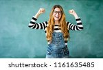 happy student with arms raised... | Shutterstock . vector #1161635485