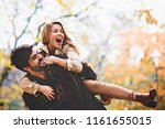 young smiling couple enjoying... | Shutterstock . vector #1161655015