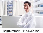 young businessman at the balcony | Shutterstock . vector #1161665455