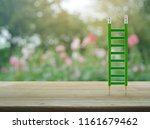 Green Pencil Ladder On Wooden...