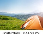 tourist tent camping in... | Shutterstock . vector #1161721192