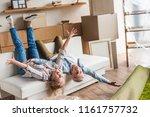 excited elderly couple lying on ... | Shutterstock . vector #1161757732