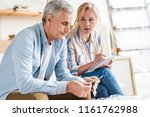 serious elderly couple counting ... | Shutterstock . vector #1161762988