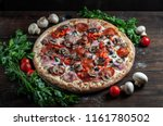 top view of fresh baked pizza...   Shutterstock . vector #1161780502