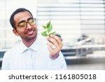 indian scientist looking at... | Shutterstock . vector #1161805018