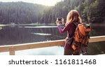 tourist girl making a photo... | Shutterstock . vector #1161811468