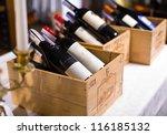 wine bottles in wooden boxes...   Shutterstock . vector #116185132