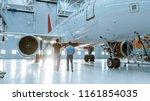 in a hangar aircraft... | Shutterstock . vector #1161854035