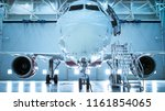 Stock photo up down shot of a brand new airplane standing in a aircraft maintenance hangar plane s door is 1161854065