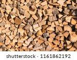 firewood background. stacks of... | Shutterstock . vector #1161862192