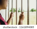 woman prison missing hand at... | Shutterstock . vector #1161894085