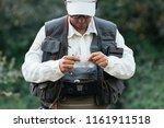 fly fisherman using flyfishing... | Shutterstock . vector #1161911518