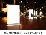 menu frame standing on wood...   Shutterstock . vector #1161918415